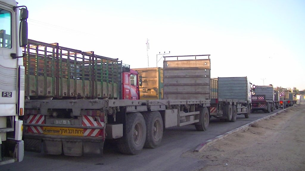 Trucks waiting to go to the Karni Abu Salem crossing to load up with goods which have been transported through Israel to Gaza - Photo take by Corporate Watch - November 2013