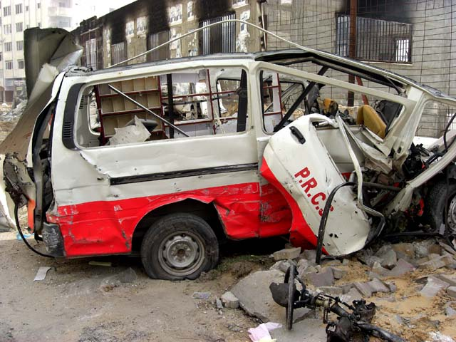 Destroyed Red Crescent ambulance outside the bombed Red Crescent storage and administrative buildings in Tel el Howa, near al Quds hospital.