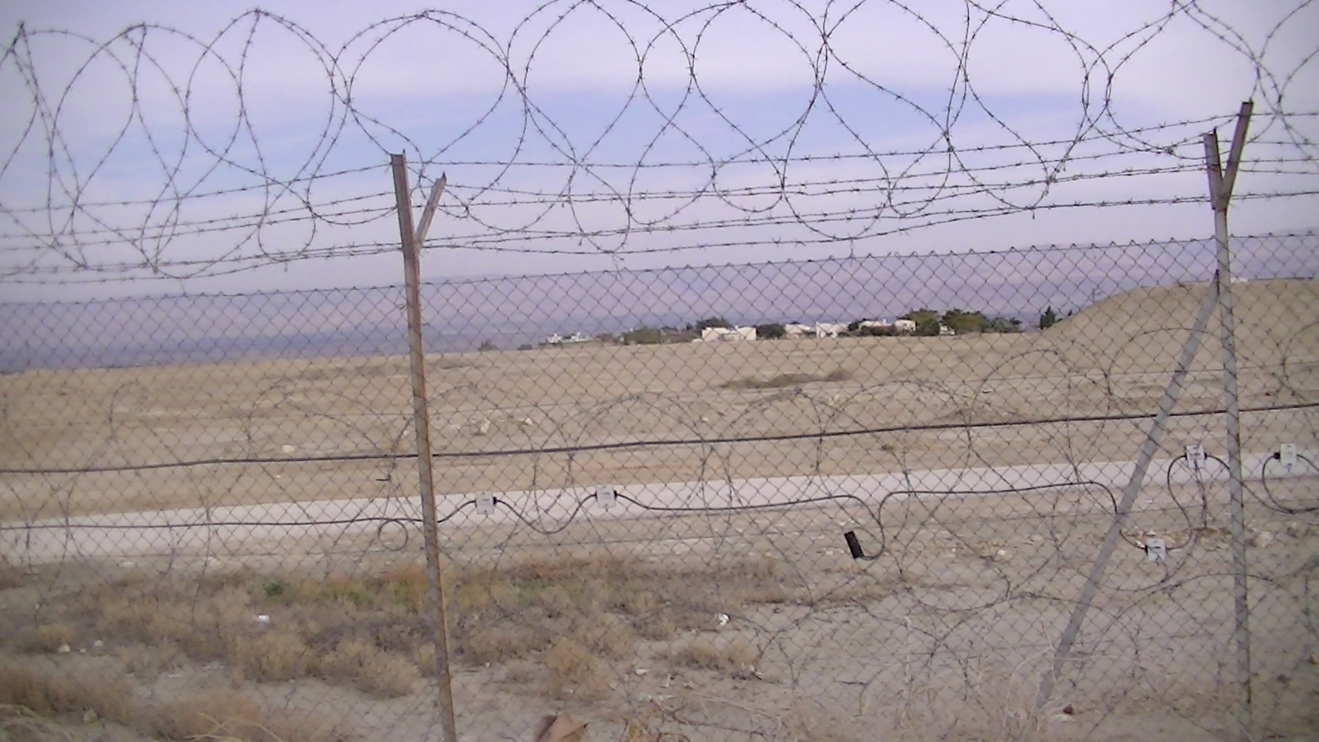 The fence surrounding Beit Ha'Arava, photo taken by Corporate Watch, February 2013