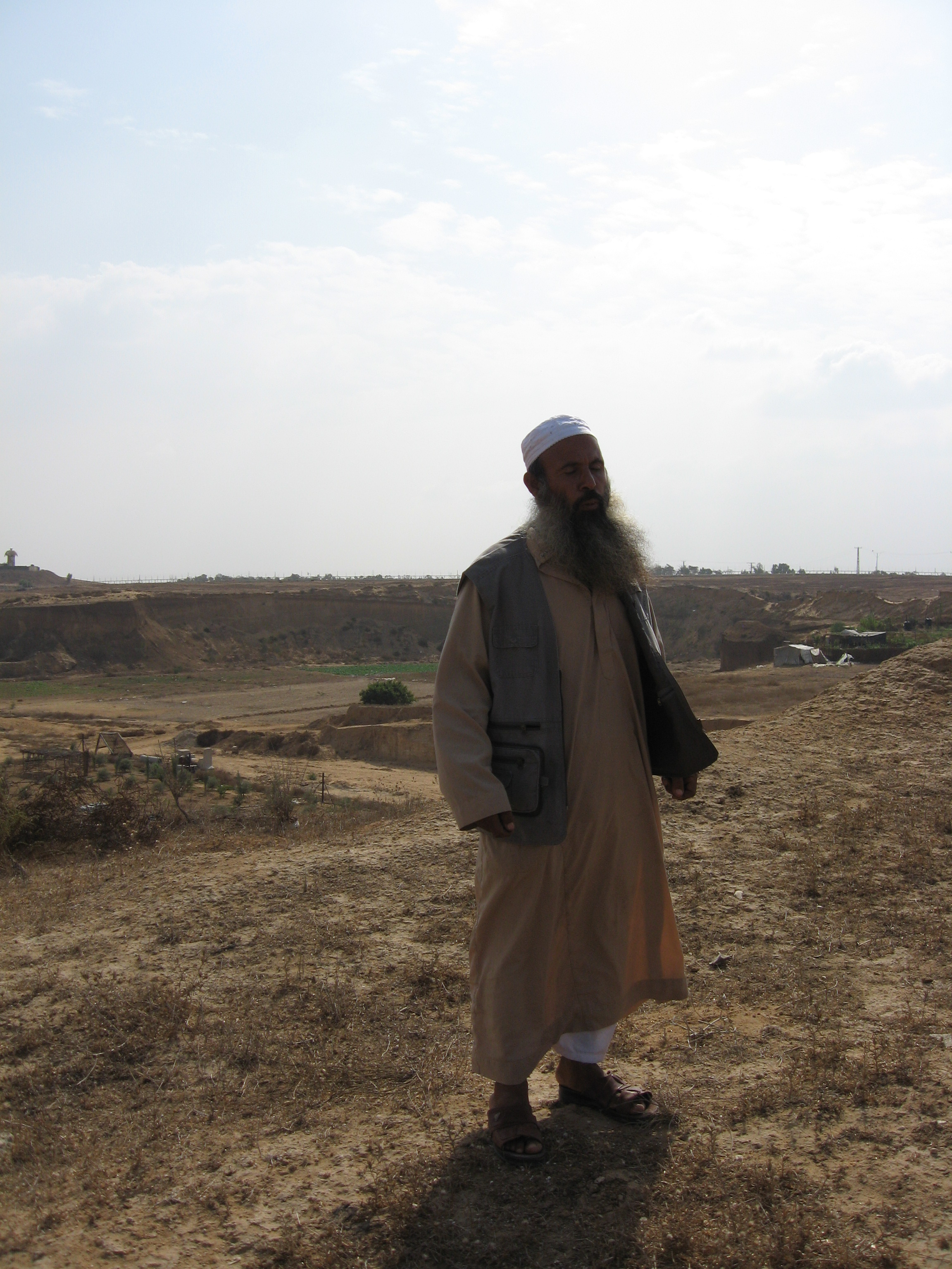 Abu Mousab on his family's land in Al  Maghazi, occupied Gaza Strip. Photo by Corporate Watch, November 2013