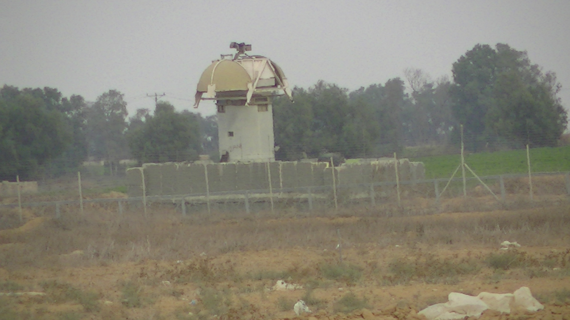 Surveillance tower in the buffer zone in Khuza'a, occupied Gaza Strip. Photo by Corporate Watch, November 2013
