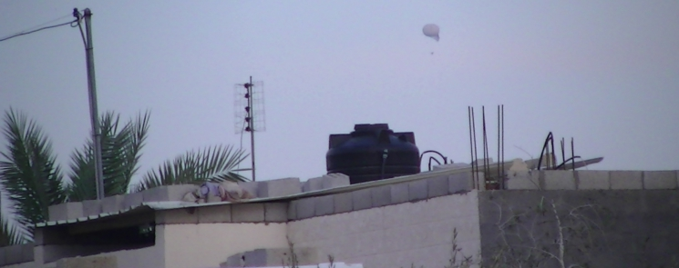 An Israeli surveillance balloon over a house in Al Qarara, close to the home of the Abu Zneid family - Photo taken by Corporate Watch, November 2013