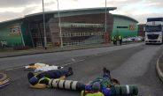 Activists blockade JCB site using concrete lock-on tubes